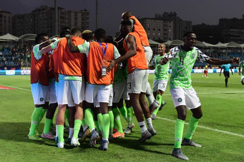 Nigeria's players celebrate their third goal during the 2019 Africa Cup of Nations (CAN) Round of 16 football match between Nigeria and Cameroon at the Alexandria Stadium in the Egyptian city on July 6, 2019. AFP)