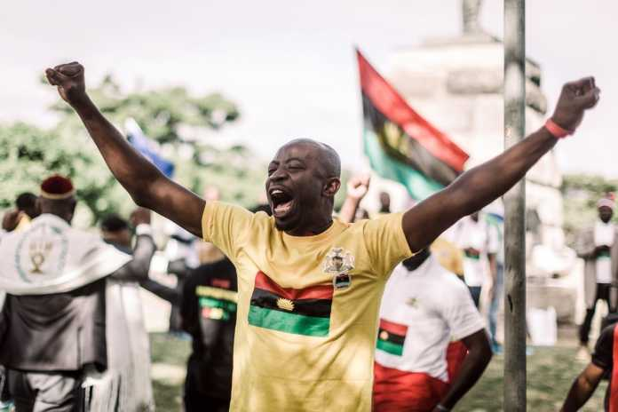 A protestor gestures as he takes part in a demonstration in Durban, South Africa, on May 30, 2019 during a Freedom March for Biafra held worldwide and organised by the Indigenous People of Biafra (IPOB) to mark the anniversary of the unilateral declaration of independence in 1967 that sparked a brutal 30-month civil war in Nigeria. (Photo AFP)