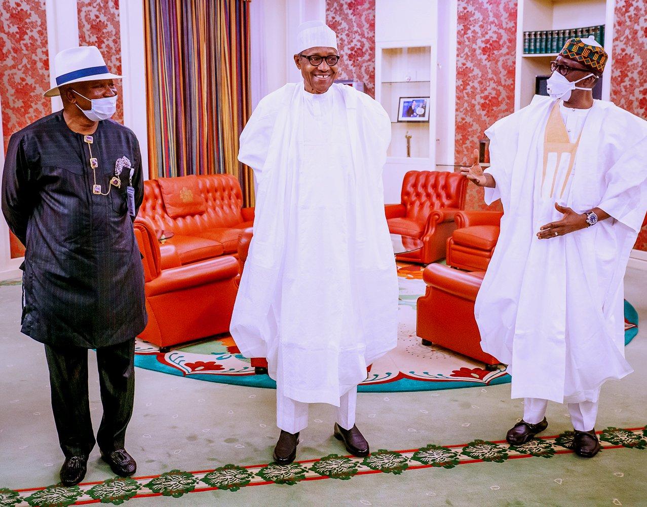 President Muhammadu Buhari(C) Major. Gen. Babagana Monguno (rtd), National Security Adviser (R) and Col. Milland Dikio (rtd), Interim Administrator, Presidential Amnesty Programme (L)
